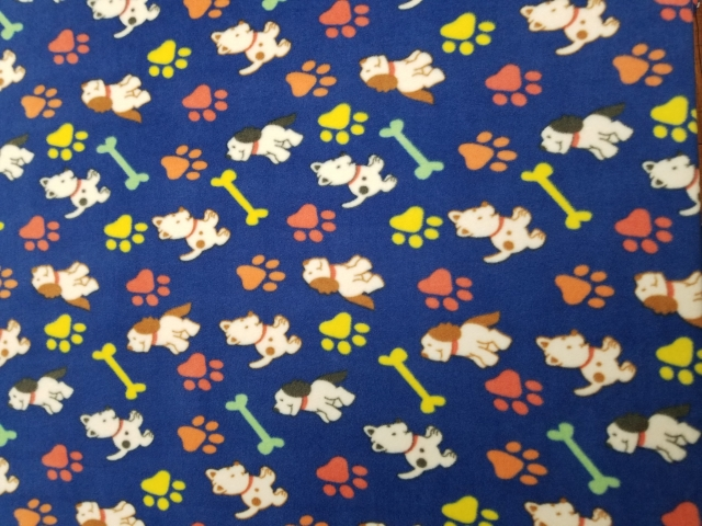 Dogs and Paws Royal Blue Fleece Fabric